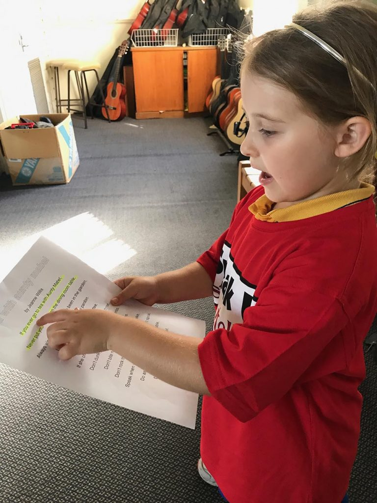 Girl reading for show and tell